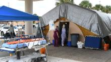 Nurses at a treatment tent outside the emergency department at Holmes Regional Medical Center in Melbourne, Florida, which serves as an overflow area for those with Covid-19 infections.