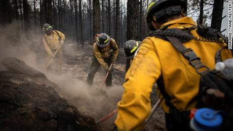 Firefighters from New Mexico work amidst heavy ash and dust to help contain the Bootleg Fire near Silver Lake, Oregon, on July 29, 2021.
