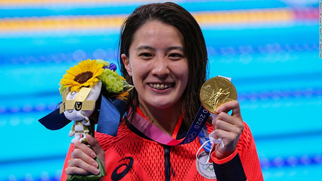 Japanese swimmer hopes gold medal rush can help heal divided nation