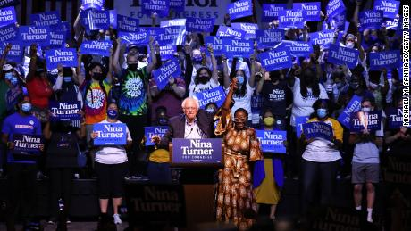 Sen. Bernie Sanders (I-VT) raises the hand of Ohio 11th District congressional candidate Nina Turner during a Get Out the Vote rally at Agora Theater & Ballroom on July 31, 2021 in Cleveland, Ohio.