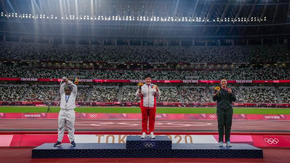Saunders performing her X gesture on the shot put medal podium.
