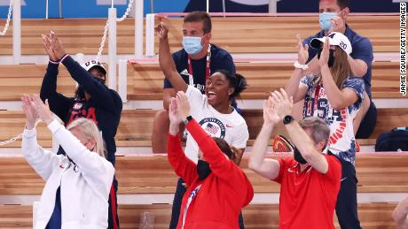 Biles cheers with teammates Jordan Chiles (left) and Grace McCallum (right) from the stands during the women's vault final.