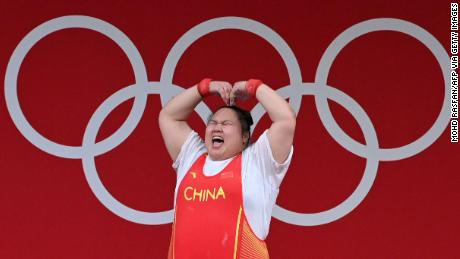 Li Wenwen celebrates during the women's +87kg weightlifting competition at the Tokyo Olympics.