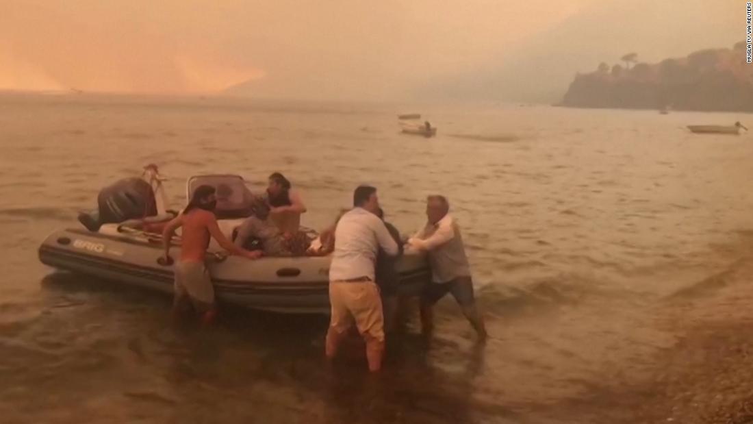 Hundreds flee popular tourist resort by boat as wildfires blaze in Turkey