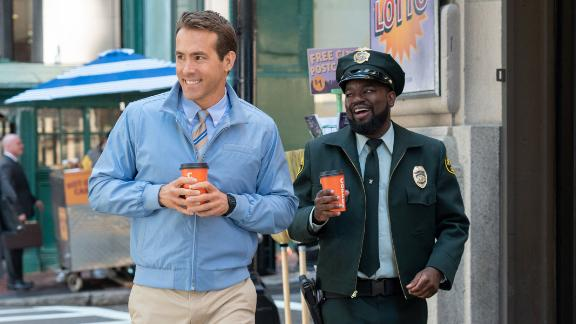 Ryan Reynolds as Guy and Lil Rel Howery as Buddy in