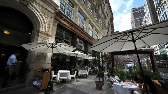 Diners are seated in the outdoor dining area of Gramercy Tavern, where owner Danny Meyer announced a vaccine mandate for all his restaurants, employees and diners will need to show proof of vaccination, New York, NY, July 30, 2021.
