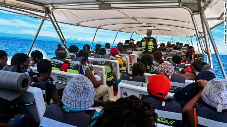 Stranded migrants from Cuba, Haiti and several African countries travel on a boat from Necocli to Capurgana, Colombia, on July 31, 2021.