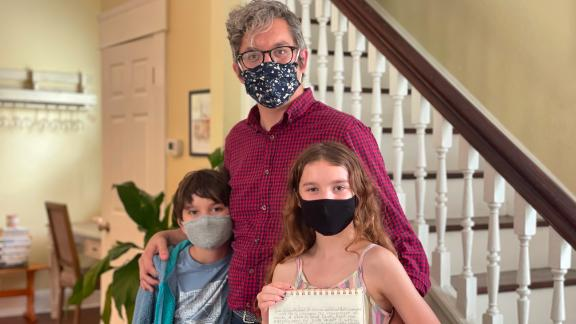Matt Hartley with his children Will and Lila, all of whom want everyone in schools to wear masks.