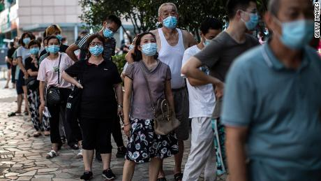 China's spiraling Delta variant outbreak hits Wuhan, as country introduces mass travel restrictions