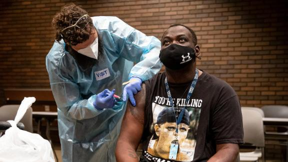 Stacy Winston, right, receives a dose of the Johnson & Johnson COVID-19 vaccine from Cody Killion, relief manager and medical assistant for HRSupport, during a COVID-19 vaccination walk-in clinic hosted by the City of Springfield and the Illinois Dept. of Public Health at the Lincoln Library in Springfield, Ill., Friday, July 30, 2021.