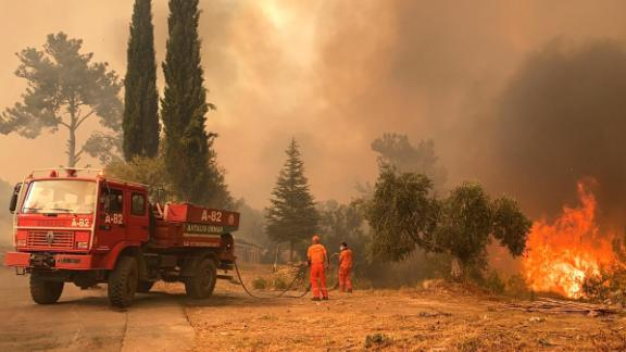A firefighter battles the blaze in a massive forest fire that engulfed a Mediterranean resort on Turkey's southern coast near the town of Manavgat on July 29.