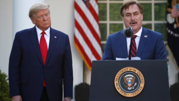 My Pillow CEO Mike Lindell speaks as President Donald Trump listens during a briefing in the Rose Garden of the White House on March 30, 2020.