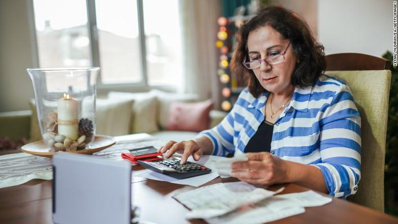 A retired woman budgets on a low income.