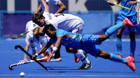 India's Vivek Sagar Prasad and Germany's Tobias Constantin Hauke compete for possession during the men's hockey bronze medal match.