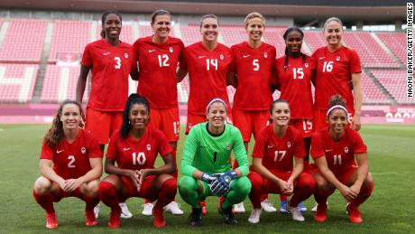 Players of Team Canada pose for a team photograph prior to the semifinal against the United States.