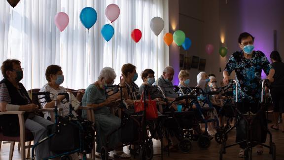 Elderly Israelis wait to receive their third shot of the Pfizer vaccine at a nursing home in Netanya on Sunday.