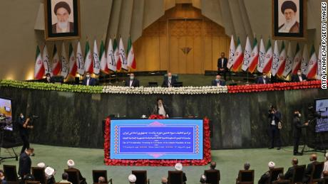 Newly-elected Iranian President Ebrahim Raisi (center) speaks during his swearing-in ceremony at the Iranian parliament in the capital Tehran on August 5, 2021.