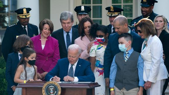 President Joe Biden signs a bill that awards Congressional gold medals to law enforcement officers that protected members on Congress at the Capitol during the January 6 riots.