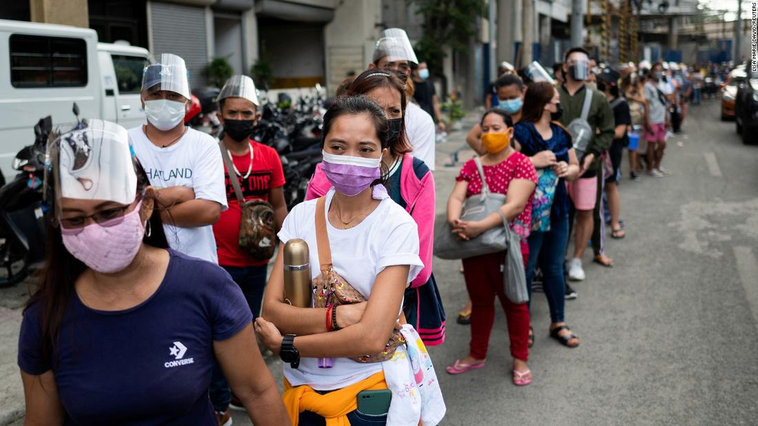 Manila residents crowd vaccination centers in rush before lockdown