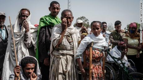 People wait to receive food aid from a local NGO in Tigray's capital Mekele in June.