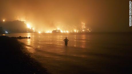 Wildfire approaches Kochyli beach on the Greek island of Evia.