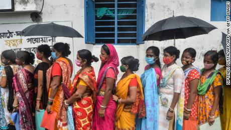 Women wait to receive the Covishield vaccine at a health center in Siliguri, West Bengal. India blocked vaccine exports in March to battle a devastating second wave of infections.