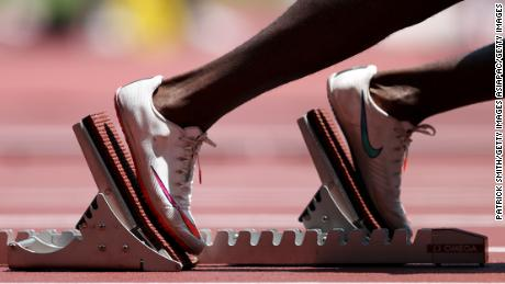 A runner takes to the starting blocks during the men's 400m heats at the Tokyo Olympics.