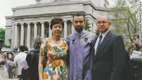 Enrique Alemán Jr., center, stands next to his parents Lupe and Enrique Alemán Sr. during his 1997 graduation from Columbia University in New York City.