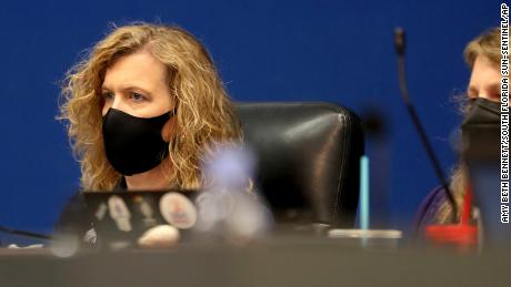 Broward County School Board Acting Superintendent Vickie Cartwright wears a mask as she listens to public comments at a Broward County School Board meeting on Tuesday.