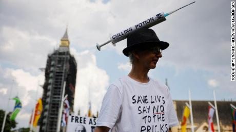 Anti-vaccination protesters against the coronavirus vaccine gather in Parliament Square outside the Houses of Parliament in central London on July 19, 2021