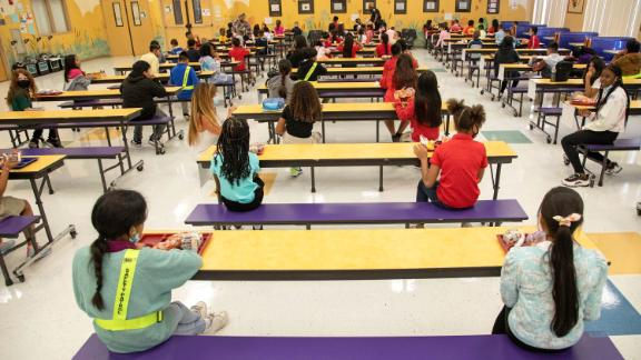 Students eat their lunch socially distanced at Belvedere Elementary School in West Palm Beach, Florida, on August 10, 2021.