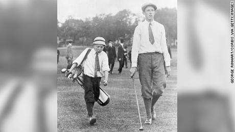 Francis Ouimet and his caddie, Eddie Lowery, play golf at Brookline in 1913.