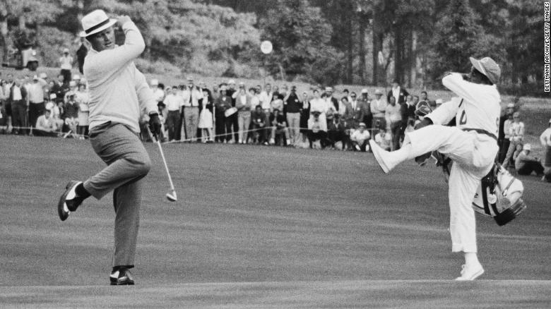 Jack Nicklaus and his caddie celebrate the birdie on the 15th hole on his way to winning the 1966 Masters.