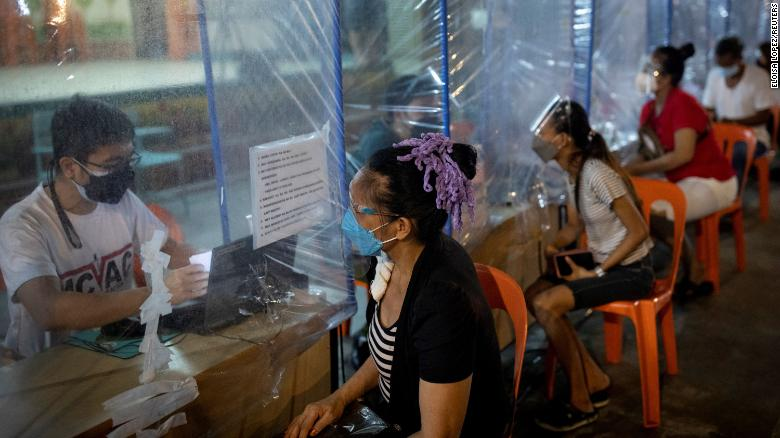 Philippine vaccination hubs open 24 hours as Delta threat grows