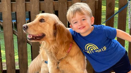 Poppy is pictured with Claire Mracek's son.