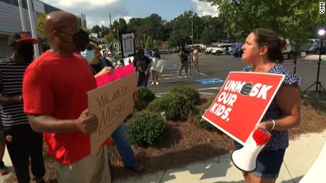 Two protesters clash at the Cobb County School District central office in Marietta last week.