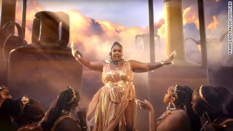 The stars feature in a gold-plated music video.