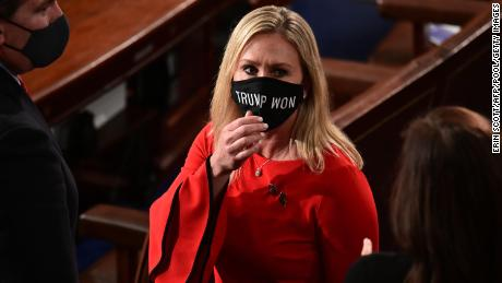 """US Rep. Marjorie Taylor Greene wears a """"Trump Won"""" face mask as she arrives on the floor of the House to take her oath of office as a newly elected member of the 117th House of Representatives in Washington on January 3, 2021."""