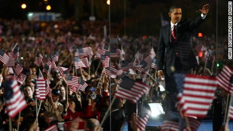 Then-President elect Barack Obama gestures during an election night victory gathering on November 4, 2008, in Chicago.