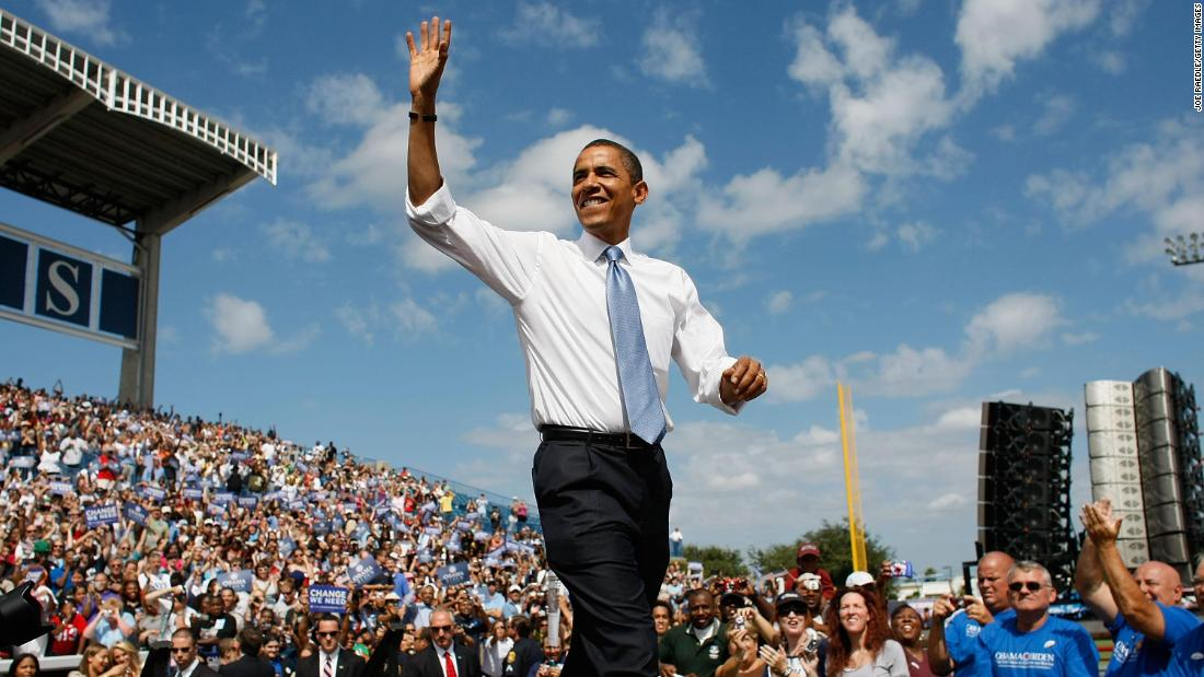 Then-Democratic presidential nominee Barack Obama waves during a campaign event on October 20, 2008, in Tampa, Florida.