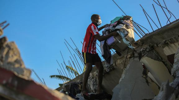 A man recovers belongings from his Les Cayes home, which was destroyed by the earthquake.