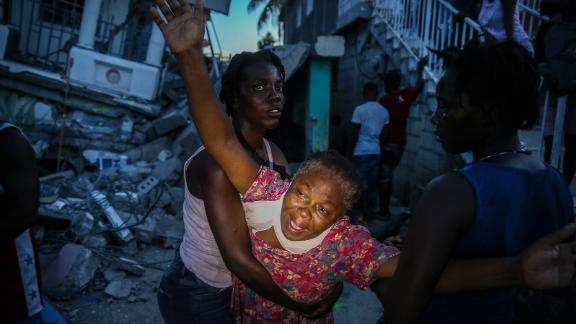 Oxiliene Morency cries out in grief after the body of her 7-year-old-daughter, Esther Daniel, was recovered from the rubble of their home in Les Cayes on Saturday, August 14.