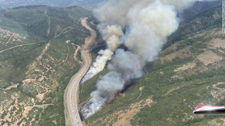 Utah wildfire forces thousands of homes to evacuate as the nation's largest fire in California rages