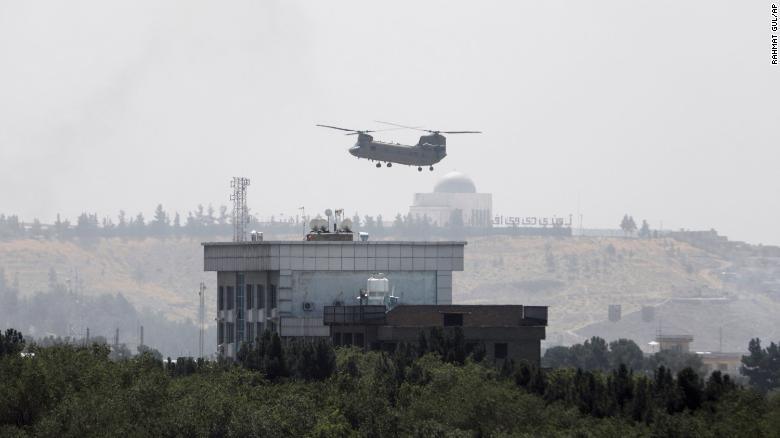 A US Chinook helicopter flies near the US Embassy in Kabul on Sunday during an operation to evacuate embassy staff.