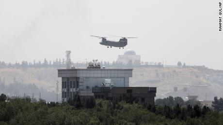 A US Chinook helicopter flies near the U.S. Embassy in Kabul on Sunday.