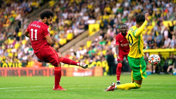 Liverpool's Mohamed Salah scores his side's third goal of the game in the 3-0 win against Norwich.
