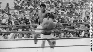 July 5 1975: Ali fights Hungarian-born British boxer Joe Bugner in their title fight at the Merdeka Stadium in Kuala Lumpur. Ali won the fight to keep his world heavyweight title.