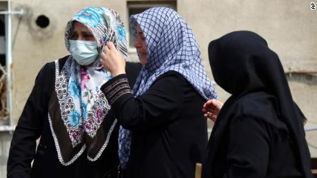 Women react as they look at the destroyed building in Bozkurt town on Saturday.