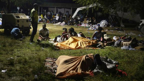 People displaced from their homes spend the night outside a hospital in Les Cayes on August 14.