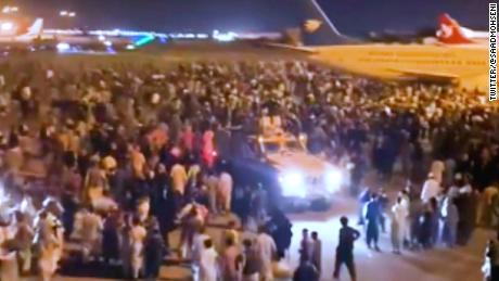 Chaos at Kabul airport as Taliban besiege Afghan capital - CNN Video